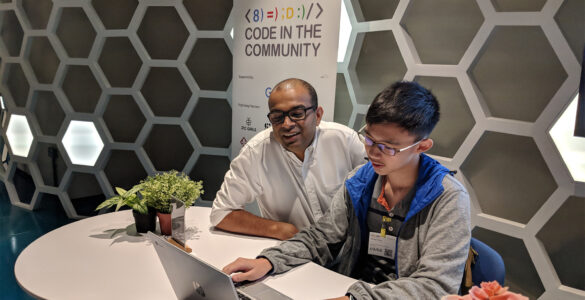 Dr. Janil Puthucheary with 14 year old student, Ethan Ong
