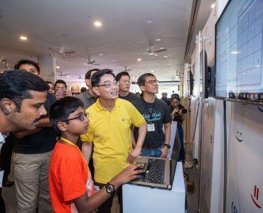 Code in the Community graduate Ramakrishnan Sanjit presenting his project to DPM Heng Swee Keat (Image courtesy of Google)